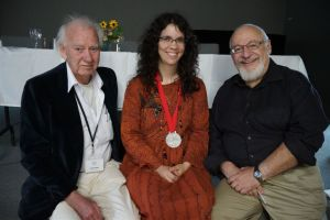 Leon Rooke, Peter Halasz, and a peculiar woman with a fabulous medal. Photo by Peter Grimaldi